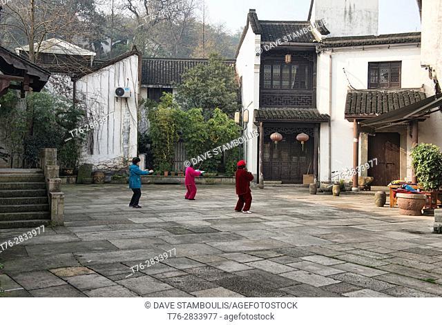 Women practicing tai chi, Hangzhou, China