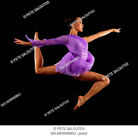 Graceful ballerina in mid air