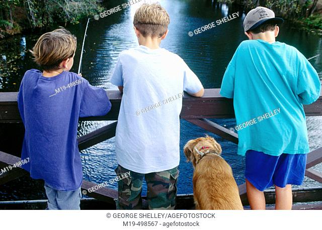 kids fishing from a bridge