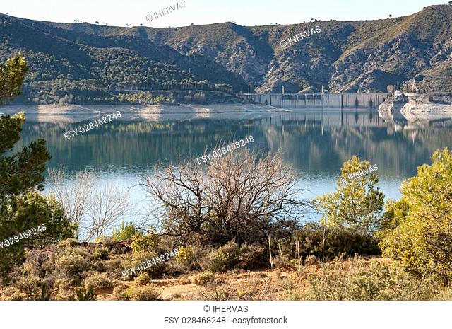 Views of Buendia Reservoir, in the upper waters of the river Tagus, Cuenca, Castilla La Mancha, Spain. The surface area of the reservoir measures 8