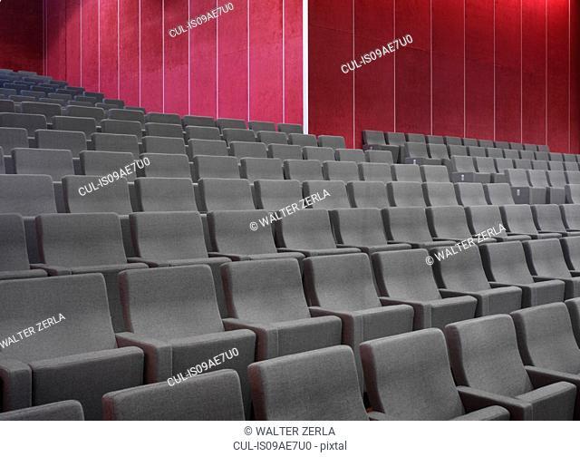 Grey chairs in empty auditorium
