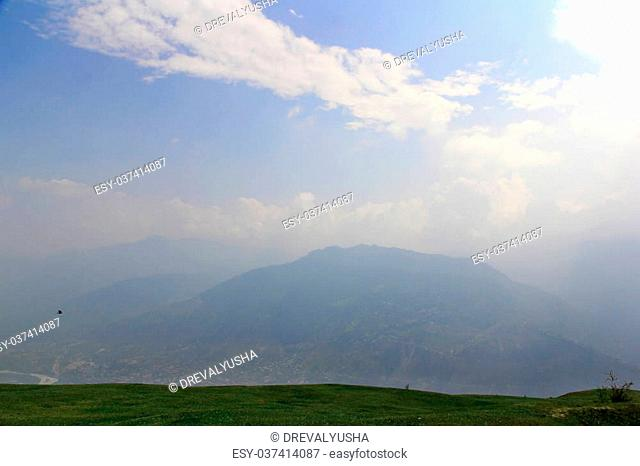 Mountian landscape in clouds and fog in Himalayas. Kullu valley, Himachal Pradesh, India