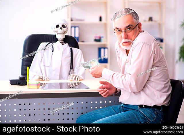 Skeleton doctor in funny medical concept