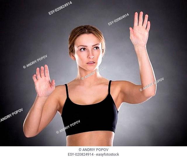Fitness Woman Touching Screen