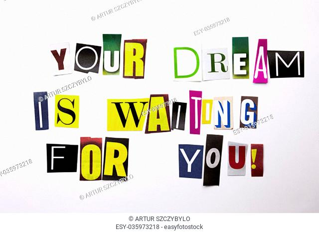 A word writing text showing concept of Your Dream Is Waiting For You made of different magazine newspaper letter for Business case on the white background with...