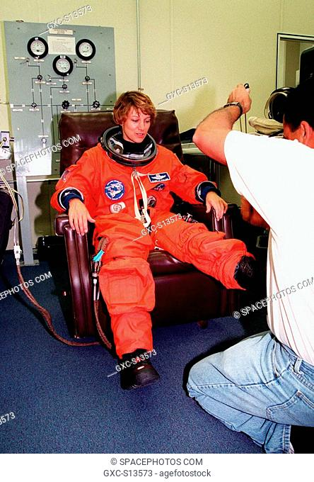 06/22/1999 --- STS-93 Commander Eileen M. Collins has her launch and entry suit checked by a technician in the Operations and Checkout Bldg