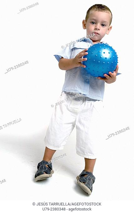 Boy with ball looking at camera