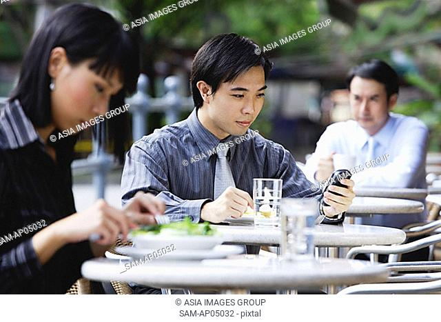 Business people at outdoor Café