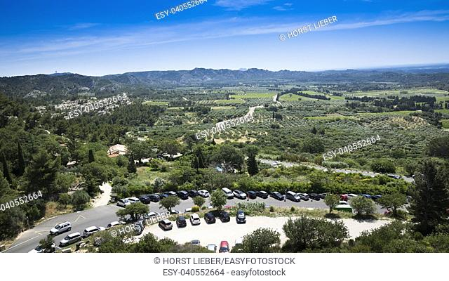 View from the fortress Les Baux-de-Provence into the valley on olive groves in the background the Alpilles. Bouches du Rhone, Provence, France, Europe