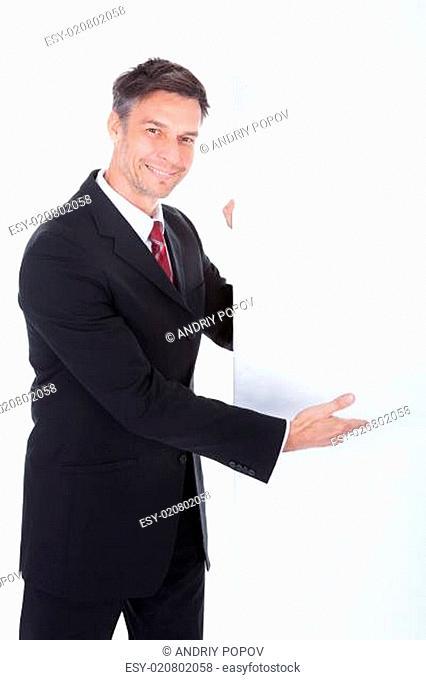 Businessman Presenting Placard