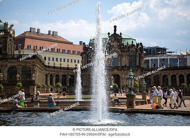 05 July 2018, Germany, Dresden: Touristspass a fountain in the interior courtyard of the Zwinger palace. Photo: Monika Skolimowska/dpa-Zentralbild/ZB