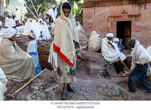 A Young Pilgrim Outside Bete Maryam Church In Lalibela At Christmas Time, Ethiopia