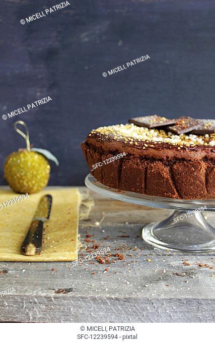 Birthday cake with sugar decorations and chocolate