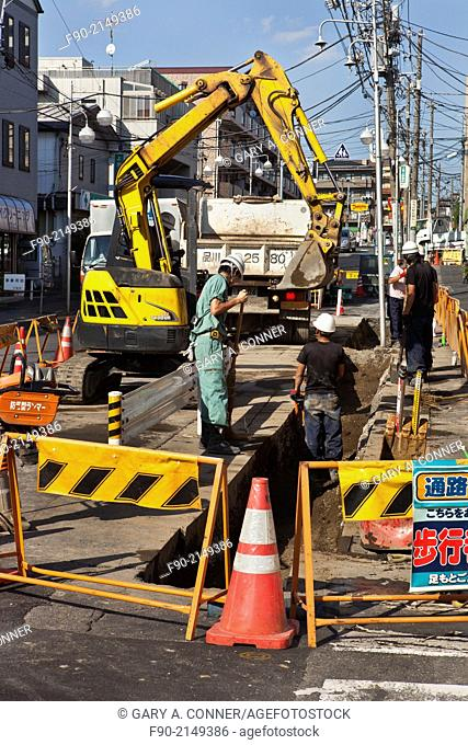 Utility construction in street in Nakaikegami, Tokyo, Japan