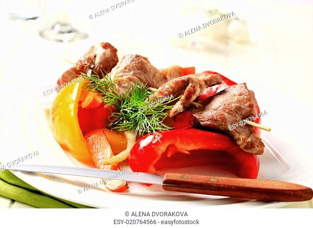 Roasted meat on skewer and baked vegetable