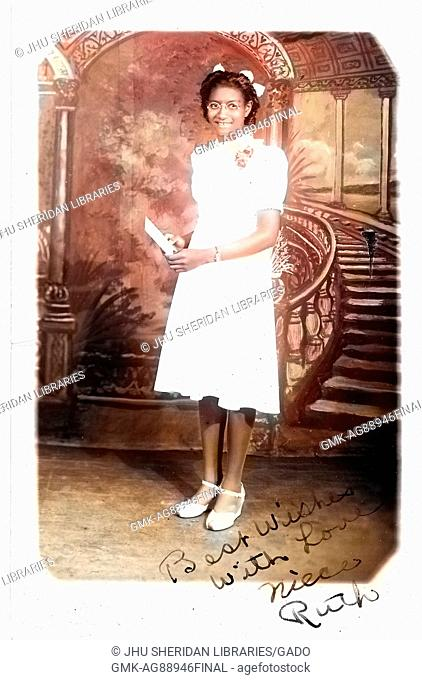 Full length portrait of young African-American woman in white knee-length dress, standing in front of fresco, 1920. Note: Image has been digitally colorized...