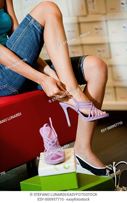 Young woman trying shoes on