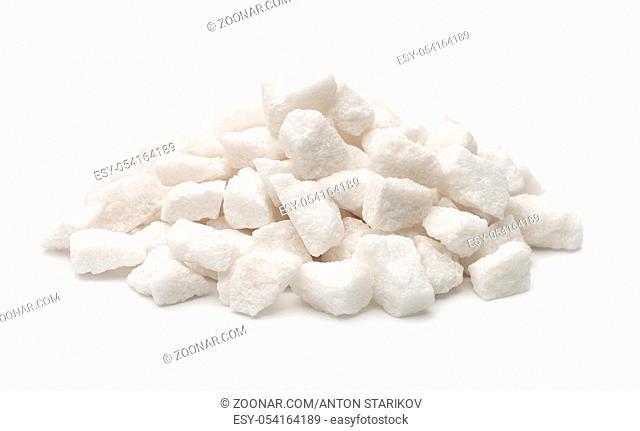 Pile of organic lump sugar isolated on white