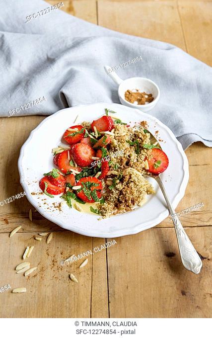 Quinoa porridge with minced strawberries and almond sticks