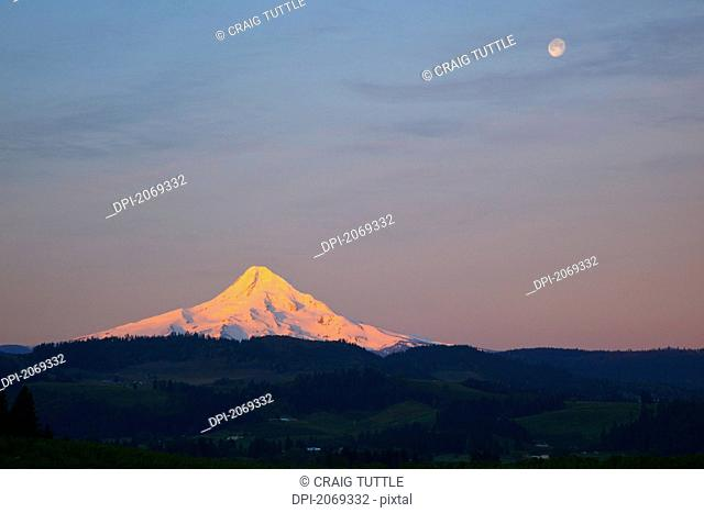 Sunrise Over Mount Hood With The Moon In The Sky, Oregon United States Of America