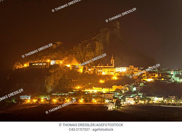 The White Town of Zahara de la Sierra below its Moorish castle at night. Cádiz province, Andalusia, Spain