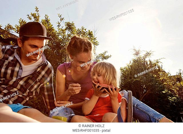 Happy family relaxing in garden