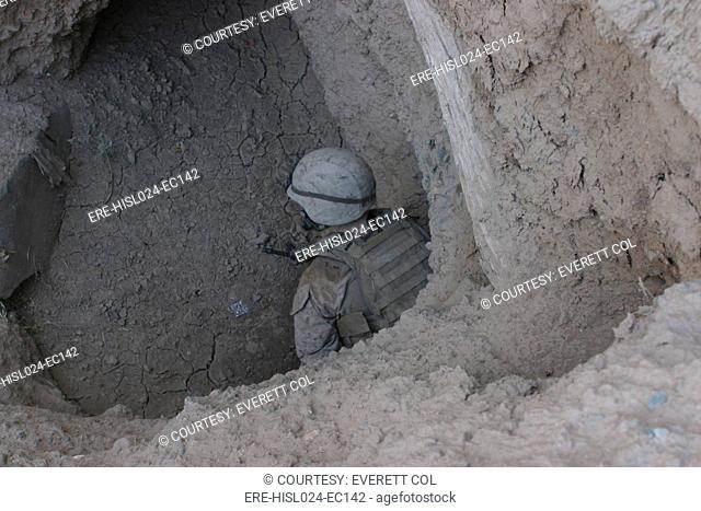 U.S. Marine in a suspected enemy passageway near Now Zad Afghanistan Oct. 5 2008., Photo by:Everett CollectionBSLOC-2011-6-53