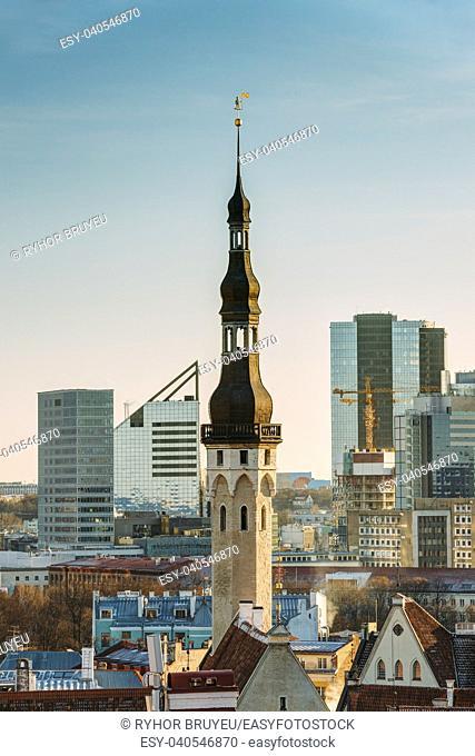 Tallinn, Estonia. Tower Of Tallinn Town Hall On Background Of Modern Architecture. Oldest Town Hall In Baltic Region And Scandinavia
