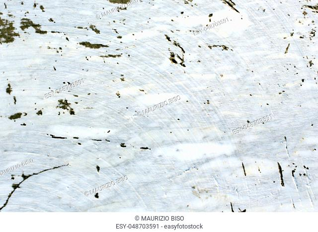 A white marble texture with stone dark defects
