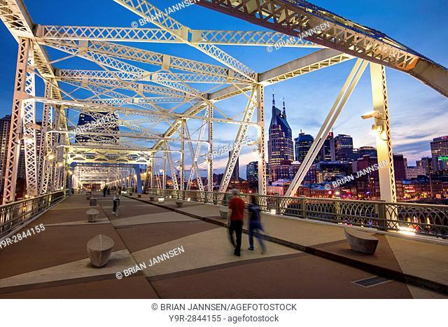 Newly named John Seigenthaler Pedestrian Bridge (formerly Shelby St Bridge - b 1907), with skyline of Nashville beyond, Tennessee, USA