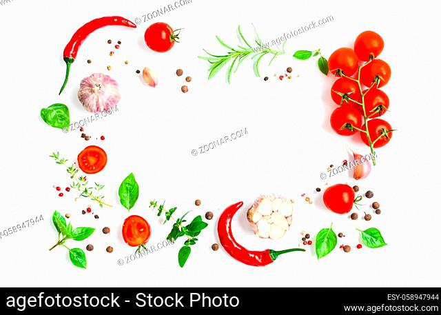 Italian herbs and spices as a frame with copy space on white background