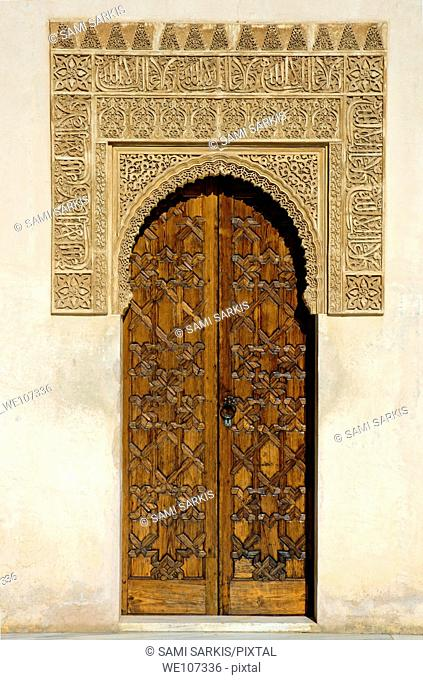 Ornate palace door in the Patio de los Arrayanes area of Alhambra, a 14th-century palace in Granada, Andalusia, Spain