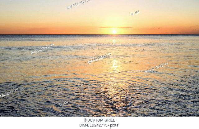 Sunset on ocean horizon