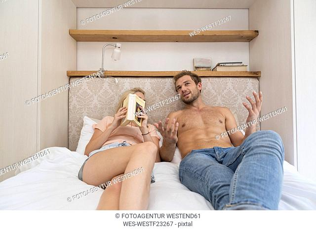 Young couple lying in bed