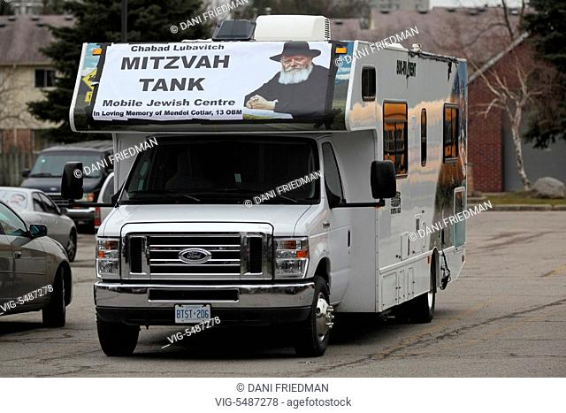 CANADA, TORONTO, 12.12.2015, A Mitzvah Tank (Mitzvah Mobile) parked by a synagogue during the holiday of Chanukah (Hanukah) in Toronto, Ontario, Canada