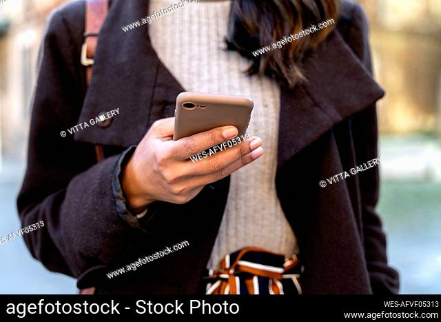 Close-up of woman holding smartphone
