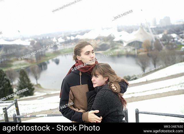 couple on Olympiaberg in Olympiapark, Munich, Bavaria, Germany