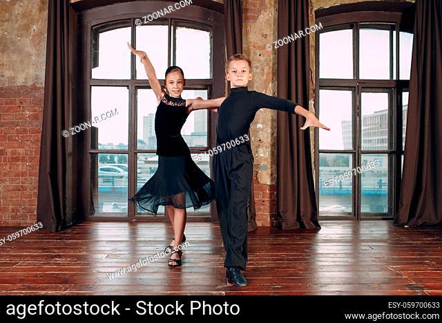 Young couple boy and girl dancing ballroom dance Rumba