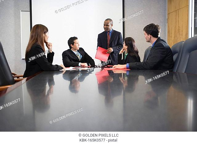 Business executives at a presentation in a formal conference room