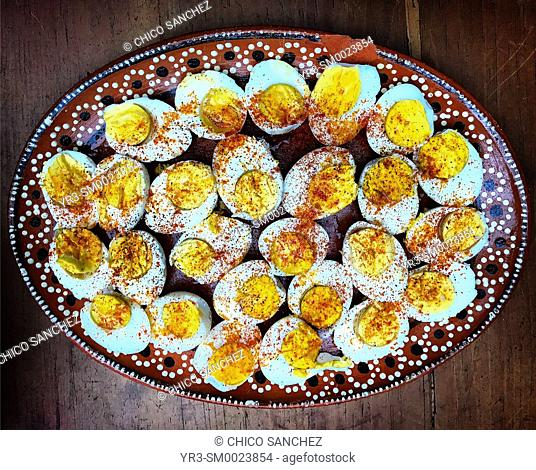 Boiled eggs with ground paprika in a home in Colonia Roma, Mexico City, Mexico