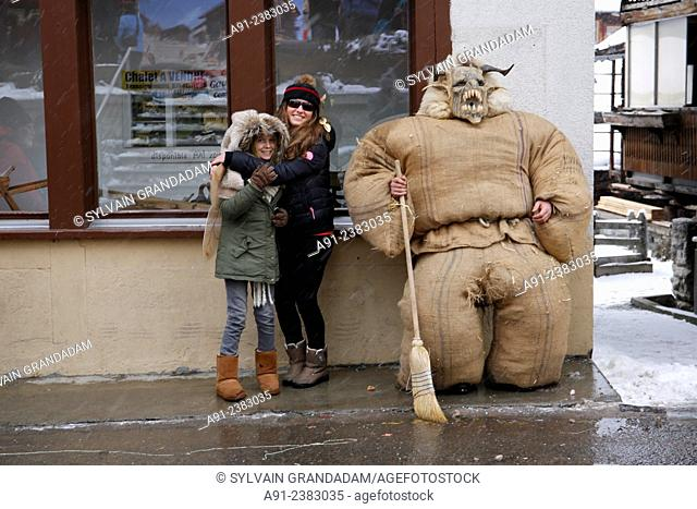 """Switzerland, Valais, Val d'Herens, village of Evolene, Carnaval, preparation of the """"""""empailles"""""""" ( young men dressed with old bags stuffed with about 50 kgs of..."""