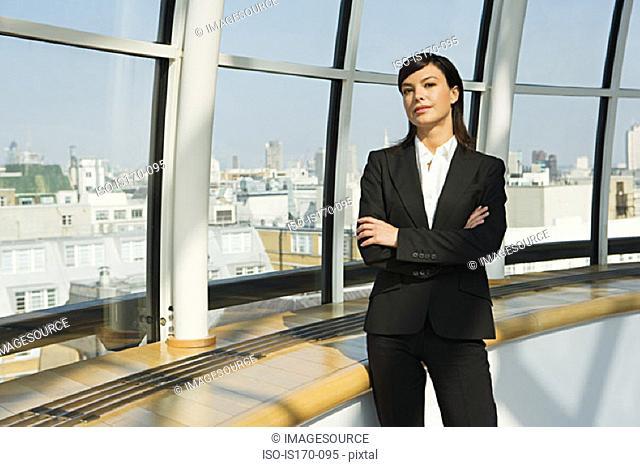 Businesswoman by a window
