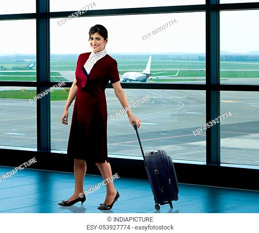 Air hostess with luggage