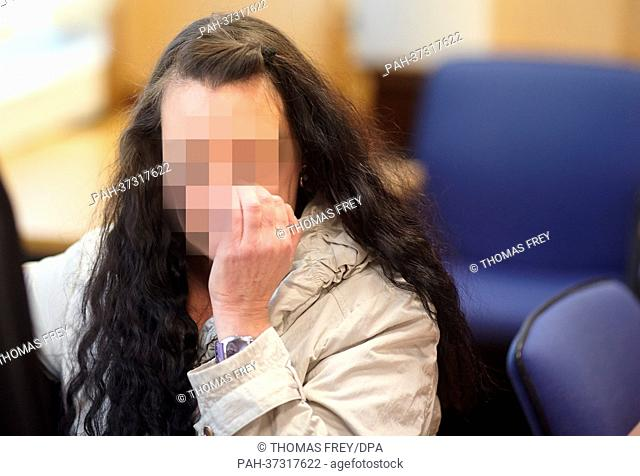 The defendant Melanie-Christin M. B. (R) sits in the courtroom of the regional court in Koblenz, Germany, 18 February 2013
