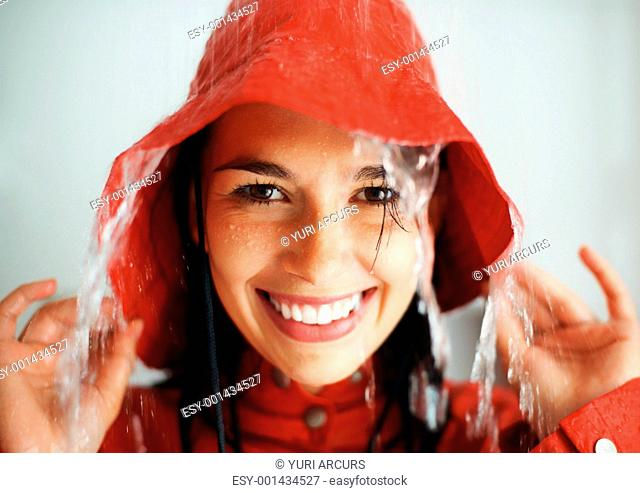 Closeup of woman getting rained on indoors