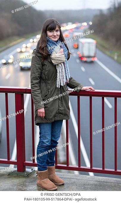 The filmmaker Elena Walter stands on a freeway bridge in Osnabrueck, Germany, 04 January 2018. The video 'Schaulustige · Sei kein Gaffer' (lit