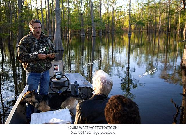 Bayou Sorrel, Louisiana - Dean Wilson, the Atchafalaya Basinkeeper, talks to visitors about the Atchafalaya River Basin during a boat tour of the swamp