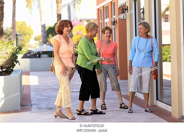 Senior friends doing outdoors shopping