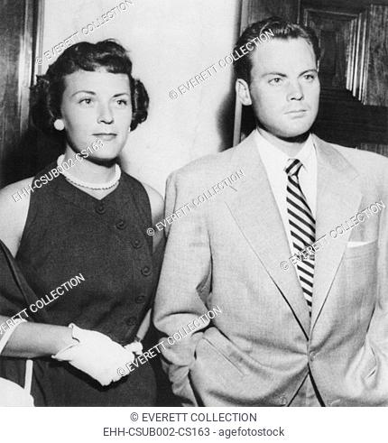 Actor John Agar in court on July 20, 1950 to face to drunk driving charges. With him is his wife Loretta Barnett Combs Agar. (CSU-2015-11-1178)