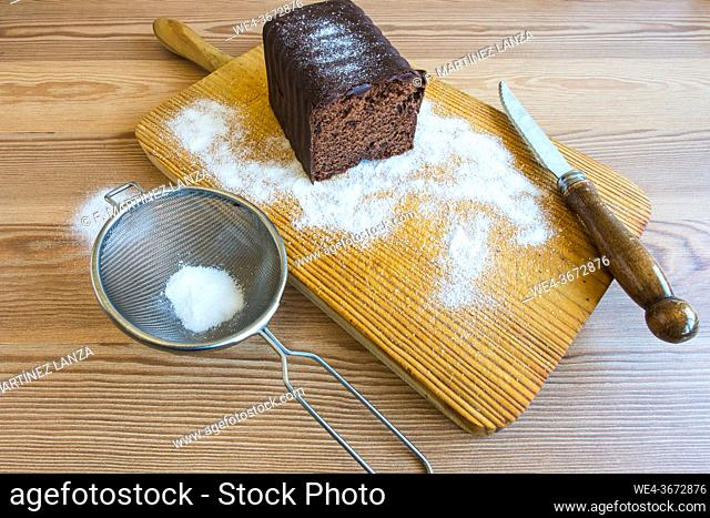 Homemade chocolate cake on a wooden board